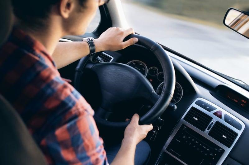 Cloesup of Man Driving a Car
