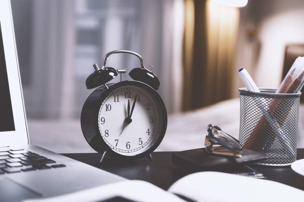 Closeup of alarm clock on a desk