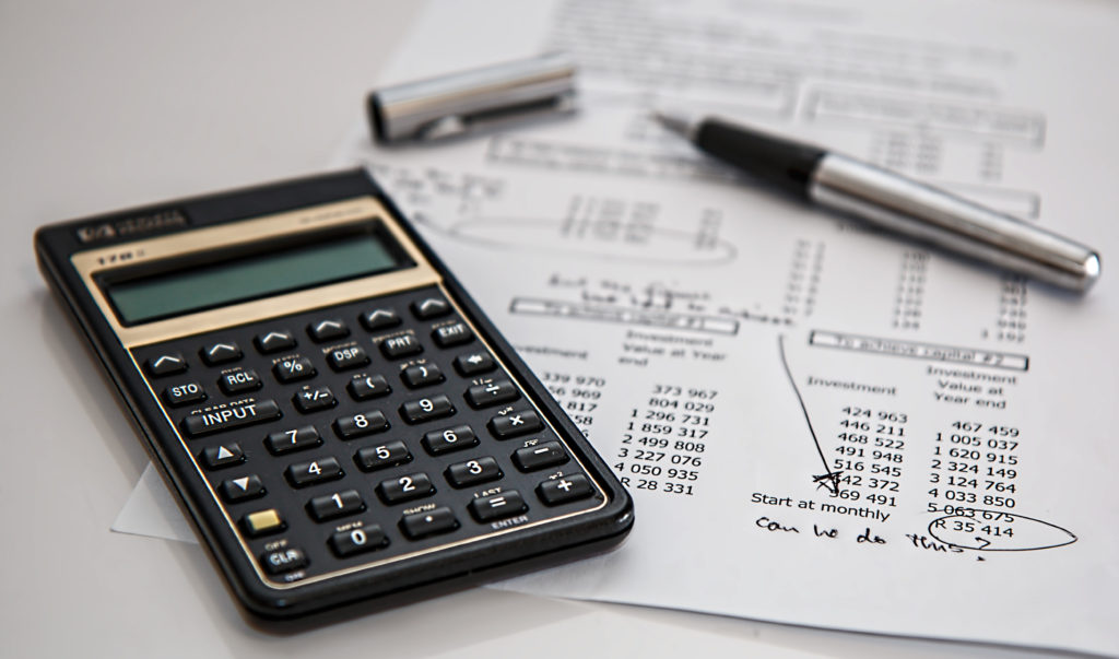 Calculator and balance sheet calculating costs