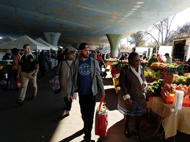 People shopping at the Sacramento Farmers Market