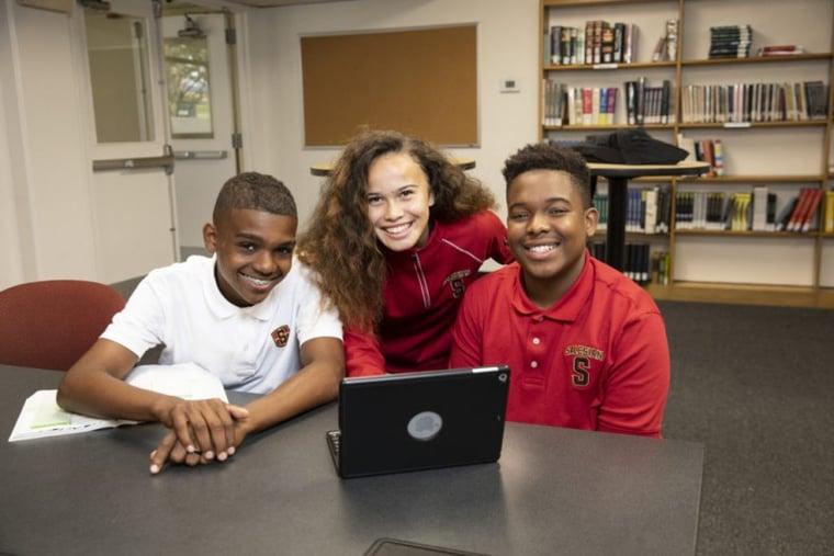 Three exchange students working together