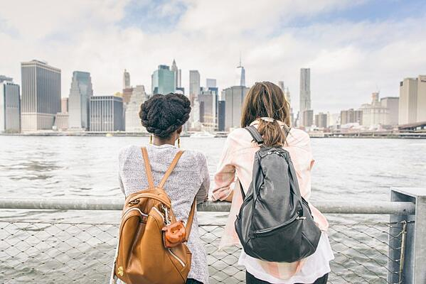 Two students overlooking city skyline